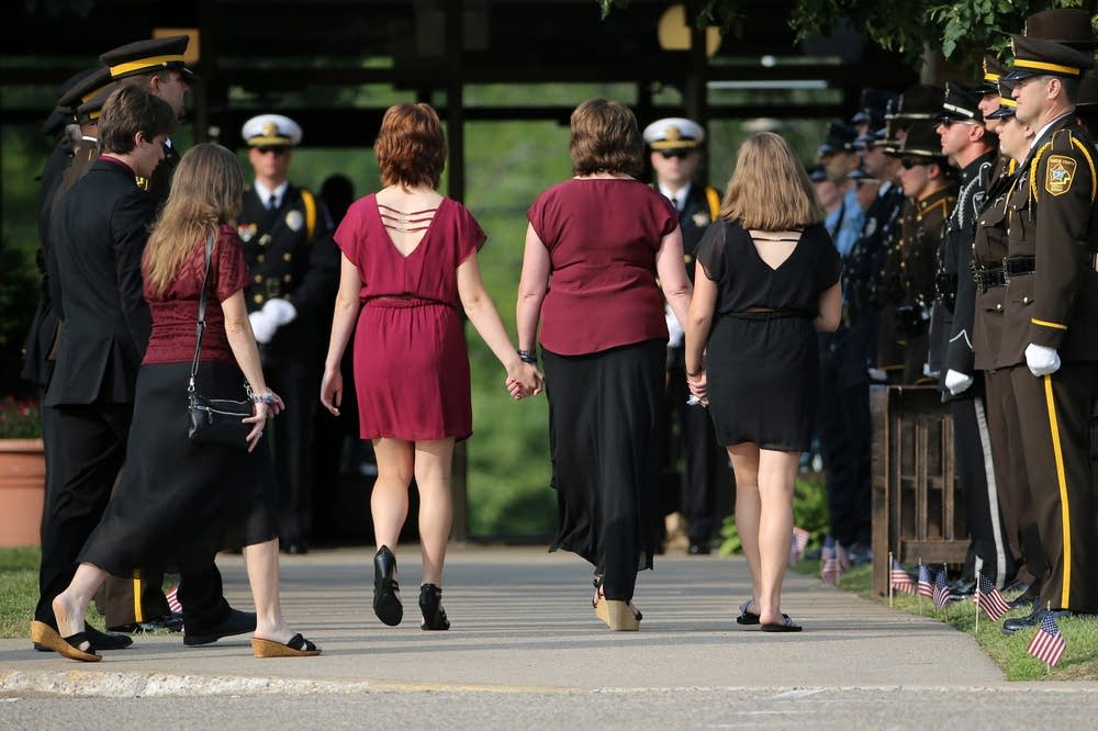 The wife and daughters of Officer Patrick