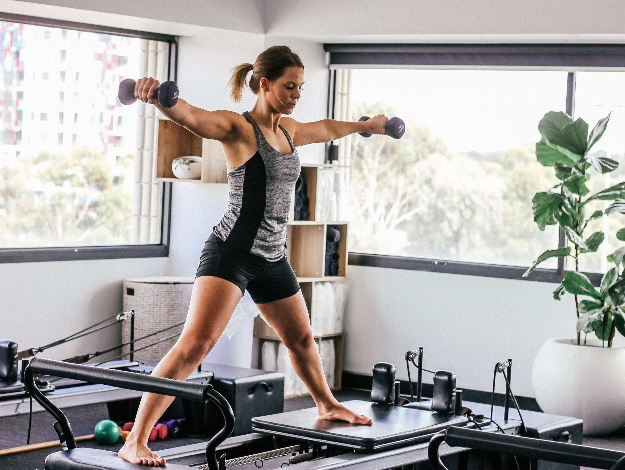 A woman exercises at home.