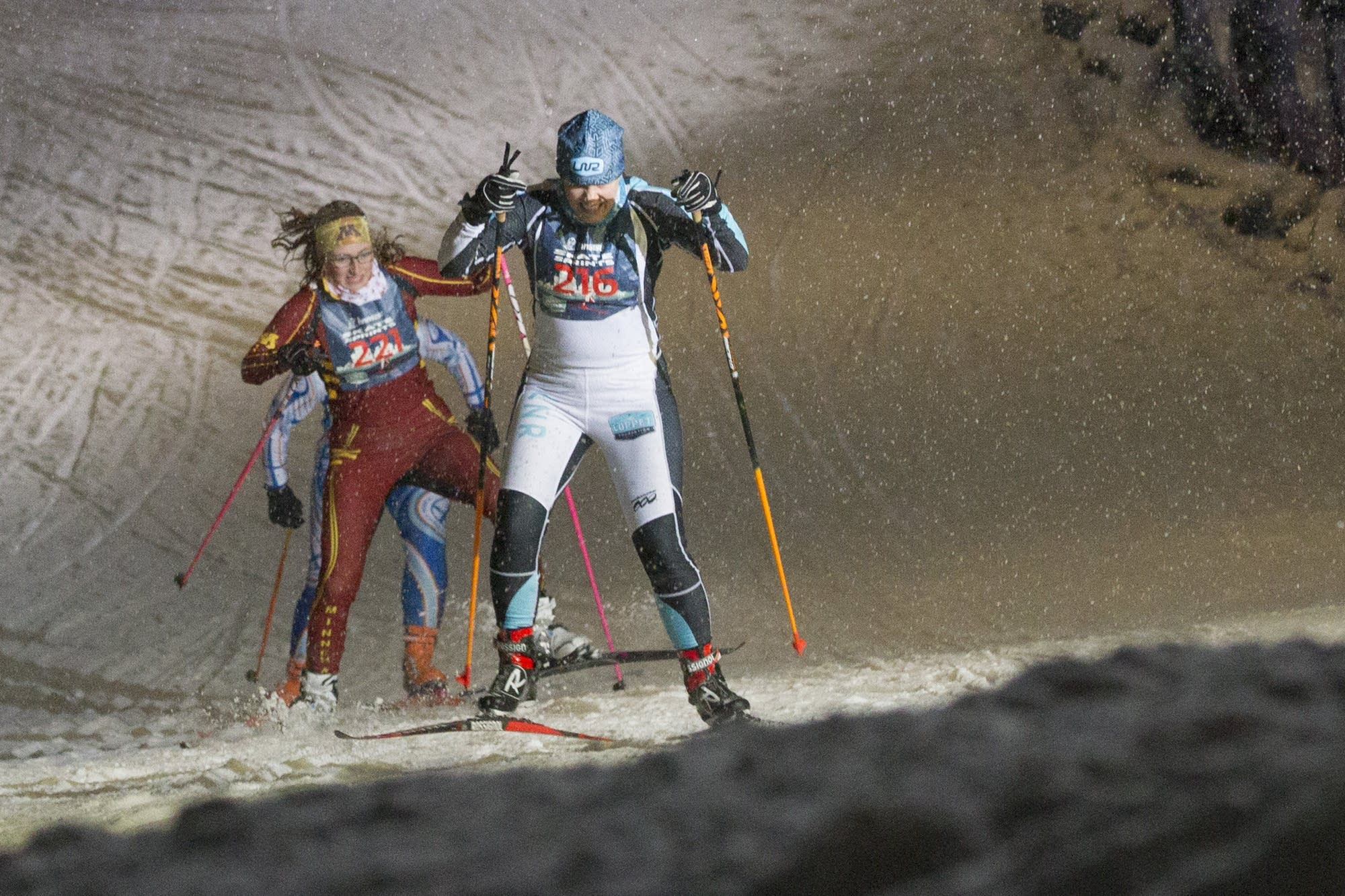Skiers Nicole Harvey and Laura Cattaneo climb the steep hill.