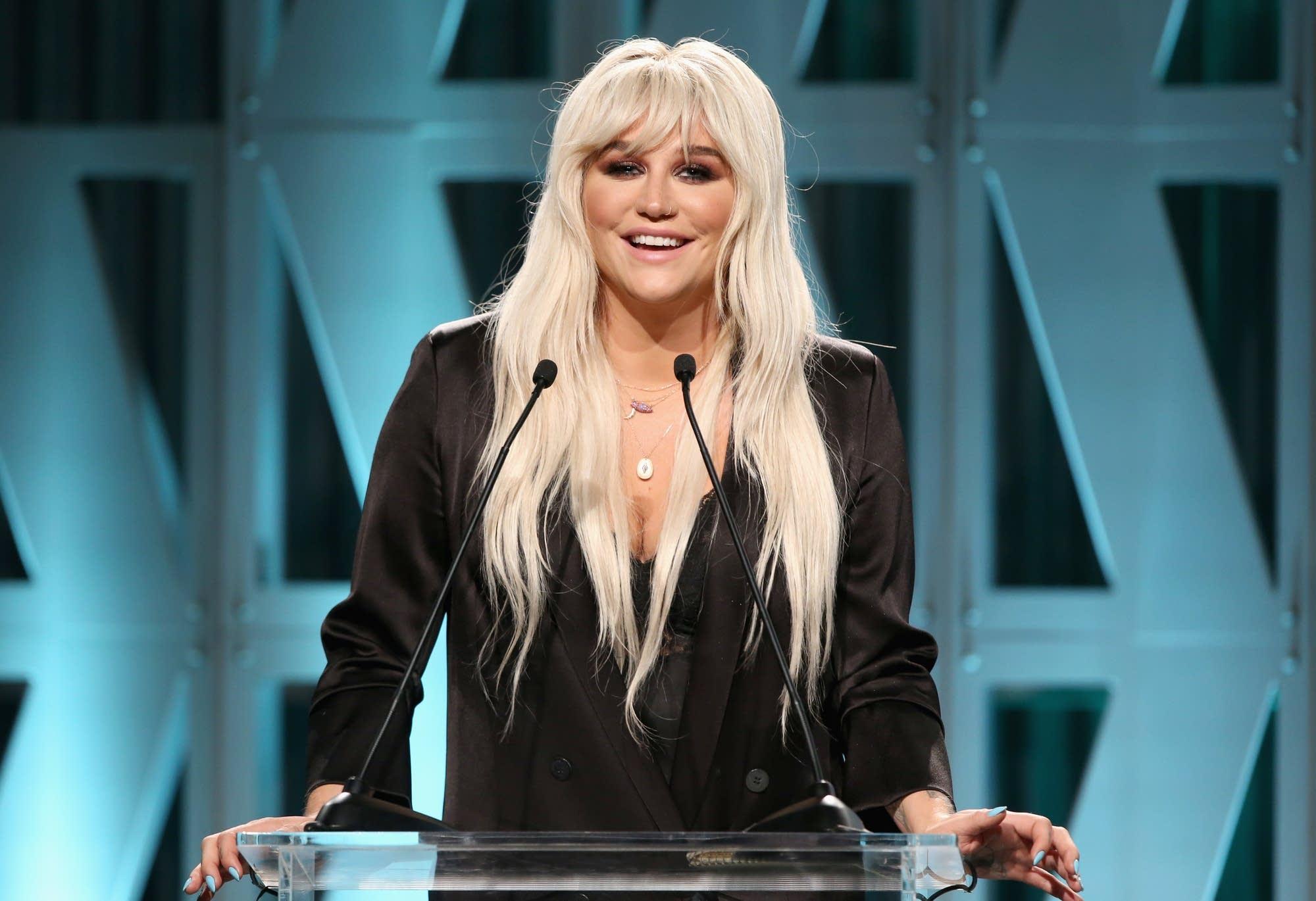 Kesha speaks onstage