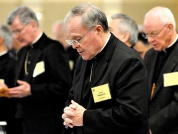 A Catholic Bishop praying