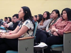 Students listen to guest speakers talk about career challenges.