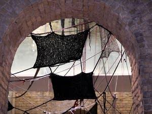 A yarn installation by artist Sheila Pepe.