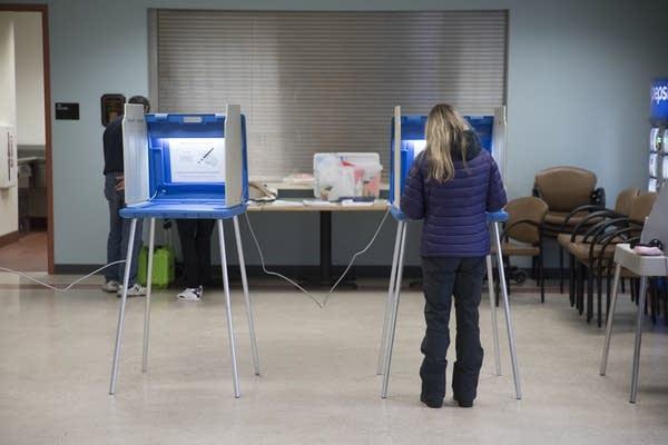 A voter cast a ballot at the Edina Senior Center.