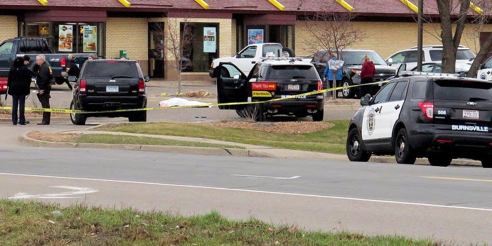Investigators work the scene
