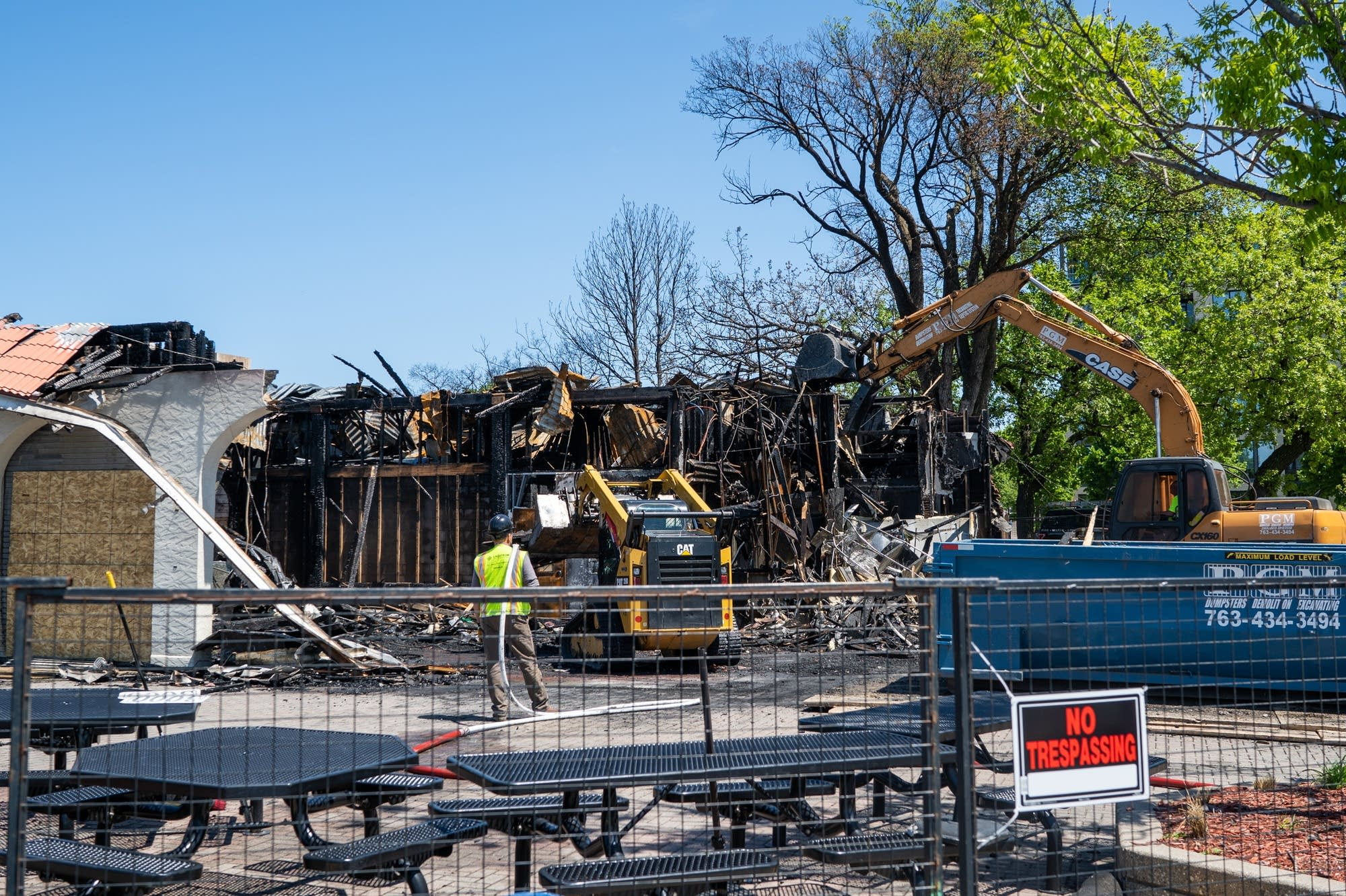 Construction workers tear down the remainder of the Bde Maka Ska pavilion.