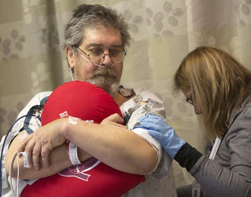 ICU patient Daniel Hage gets a skin check.