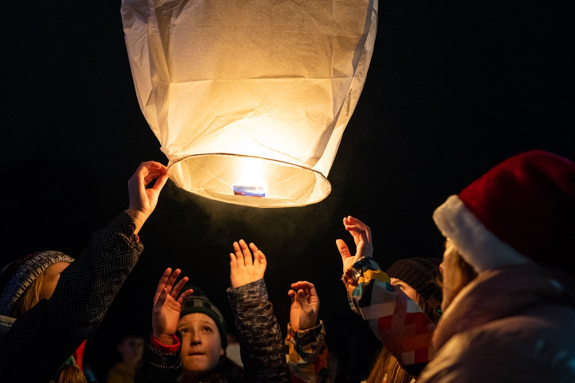 Barron middle school students release peace lanterns into the night sky.