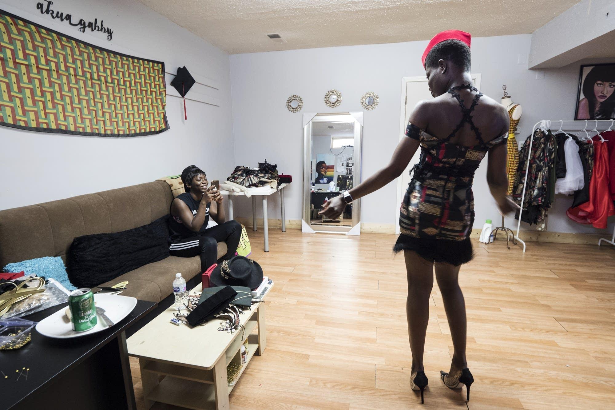 Designer Jacqueline Addison takes a video of model Setor Nyendu walking.