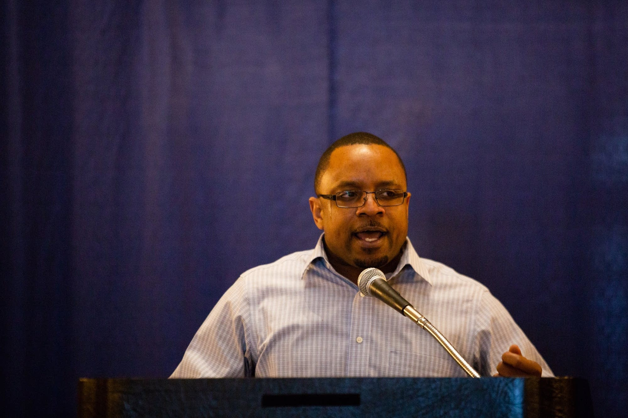 Terencio Safford speaks at a rally supporting voting rights of felons.