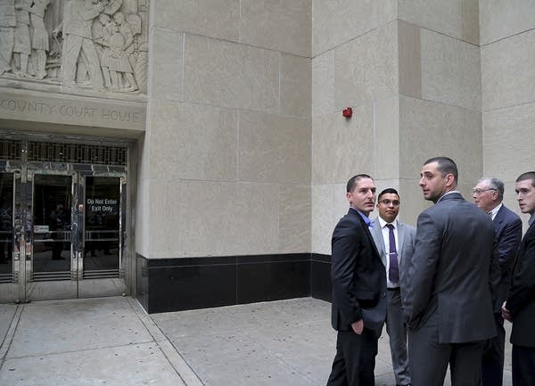 Jeronimo Yanez and his attorneys stand outside the Ramsey Co. Courthouse.