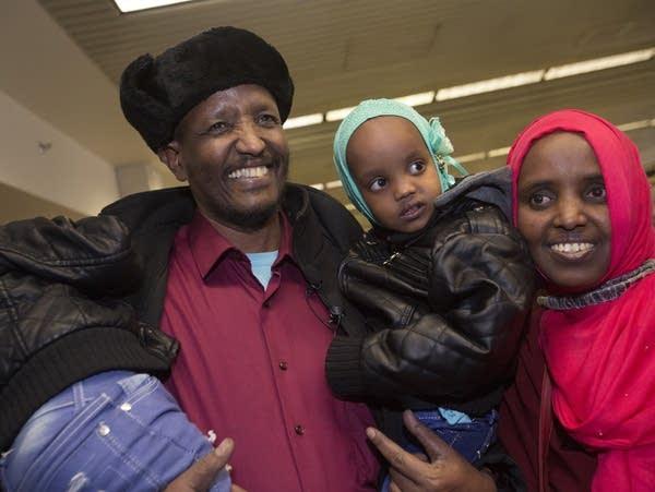Mahamed Iye greets his wife Saido Ahmed Abdille.