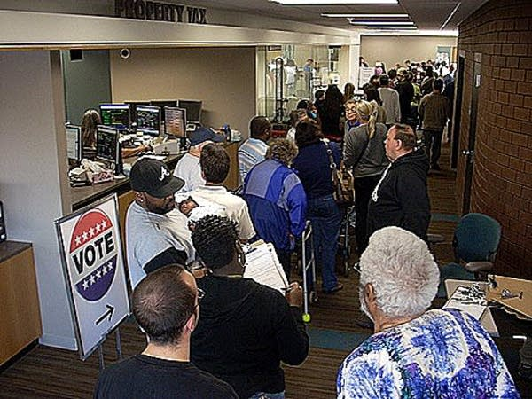 Absentee voters wait in line in Ramsey County