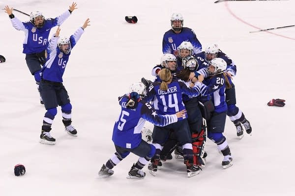 The U.S. celebrates after beating Canada.
