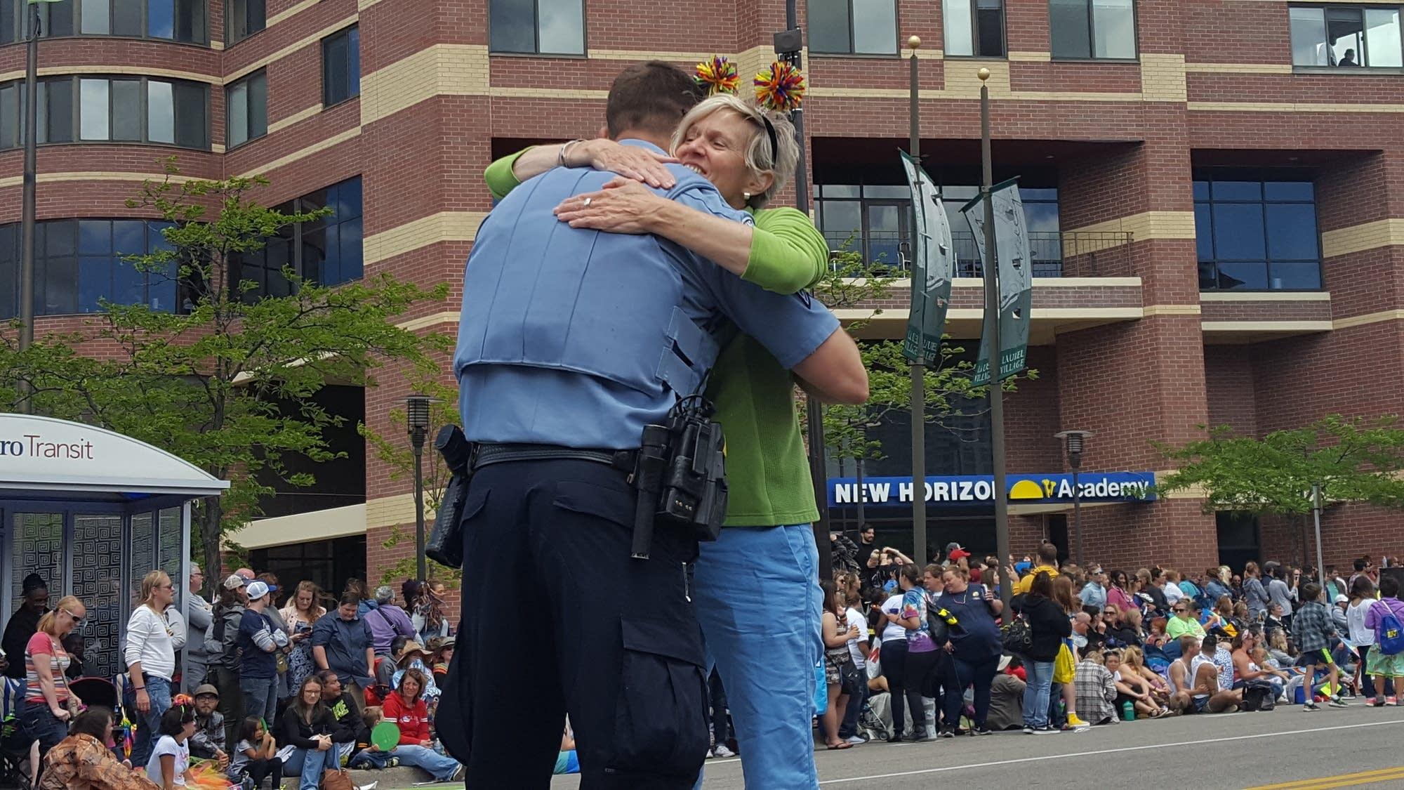 A Pride attendee hugs Minneapolis Polcie Sgt. Deitan Dubuc.