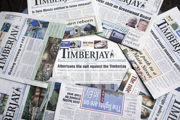 Various TimberJay newspapers sit on a table.
