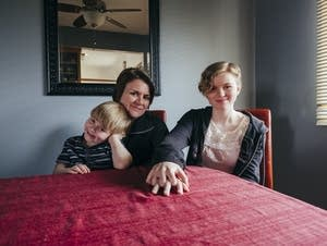 Melissa Stearns sits with her two children in their White Bear Lake home.