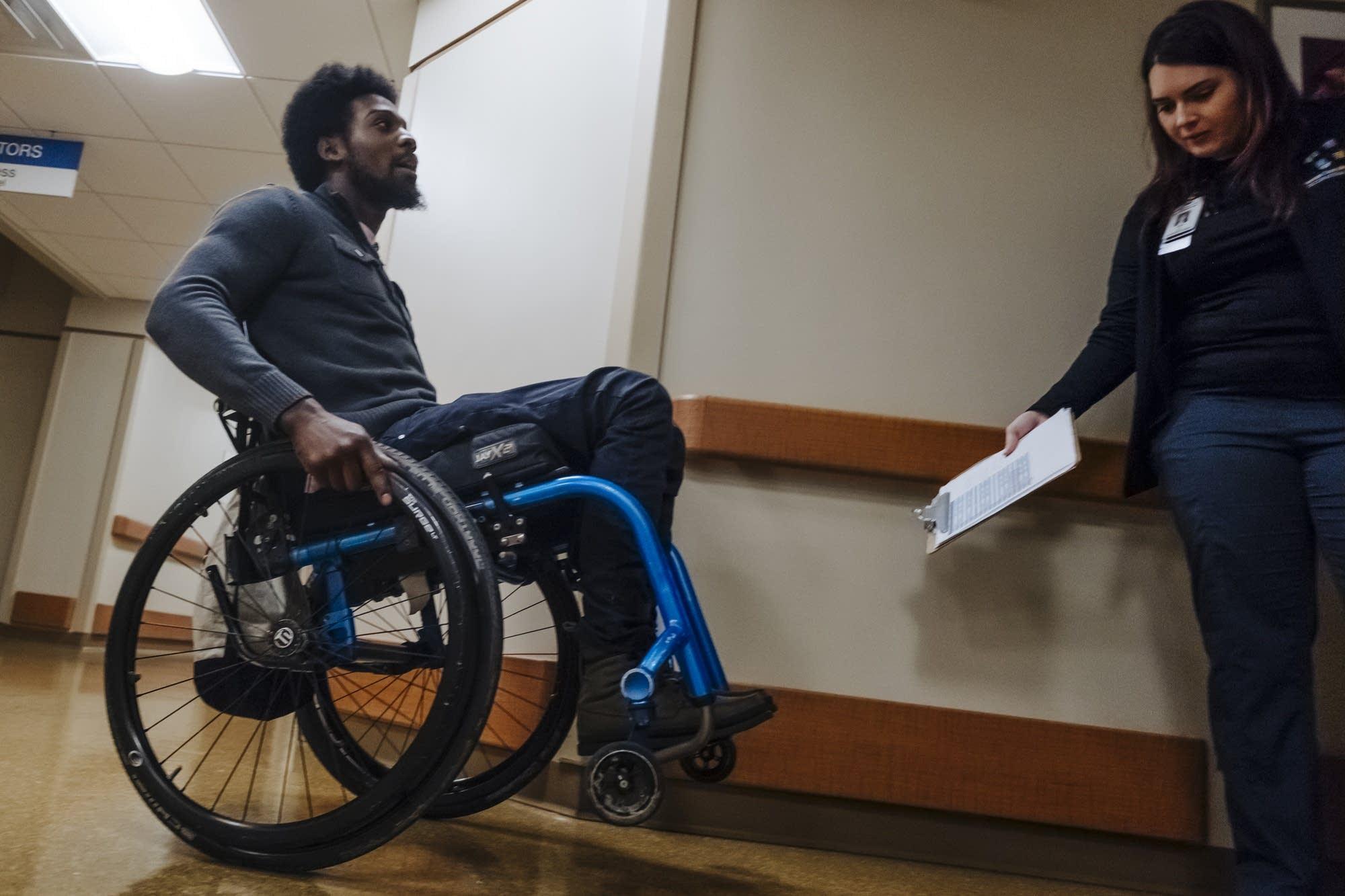 D'Andre Alexander wheelies in his wheelchair.