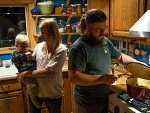 Yvette Ibrahim holds Zein while her husband, Tamer, heats up dinner.