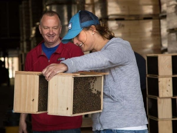Patrick Montague from Mann Lake hands over a set of bee crates.
