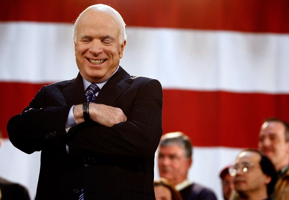 McCain laughs during a campaign rally