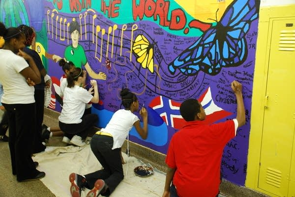 Students work on a mural