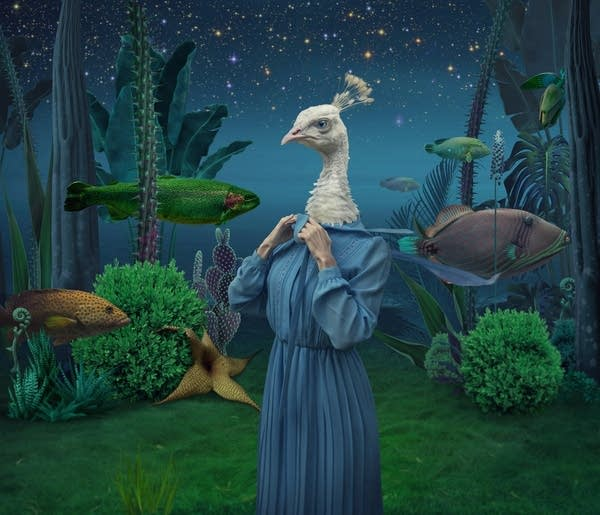 A surreal dreamscape showing a chicken lady underwater with fish