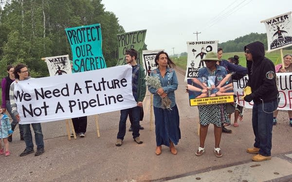Winona LaDuke and others rally at the Wisc. - Minn. border.