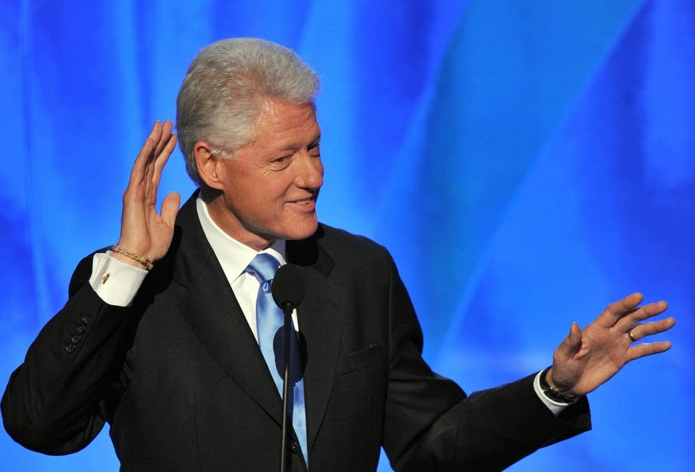 Bill Clinton listen to cheers at the DNC