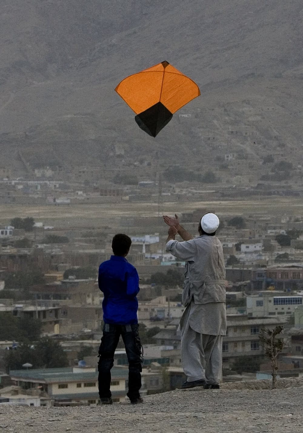Afghans fly a kite