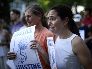 Betsy Custis, right, and others attend a march in honor of Justine Damond.