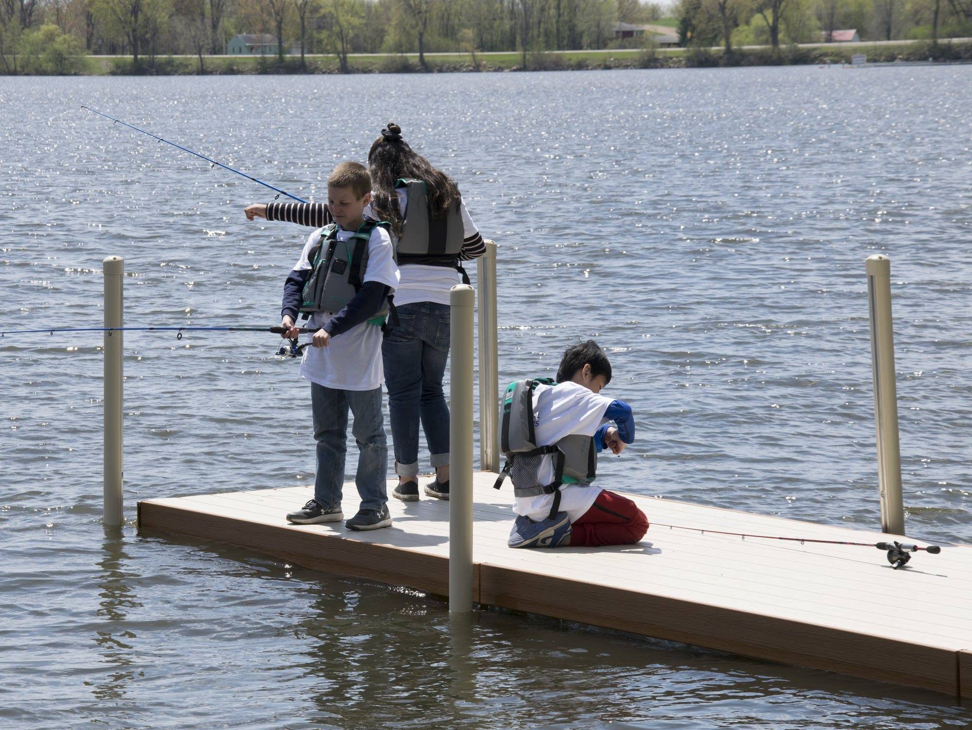Young anglers learn how to fish at the kids' fishing event in Albert Lea.