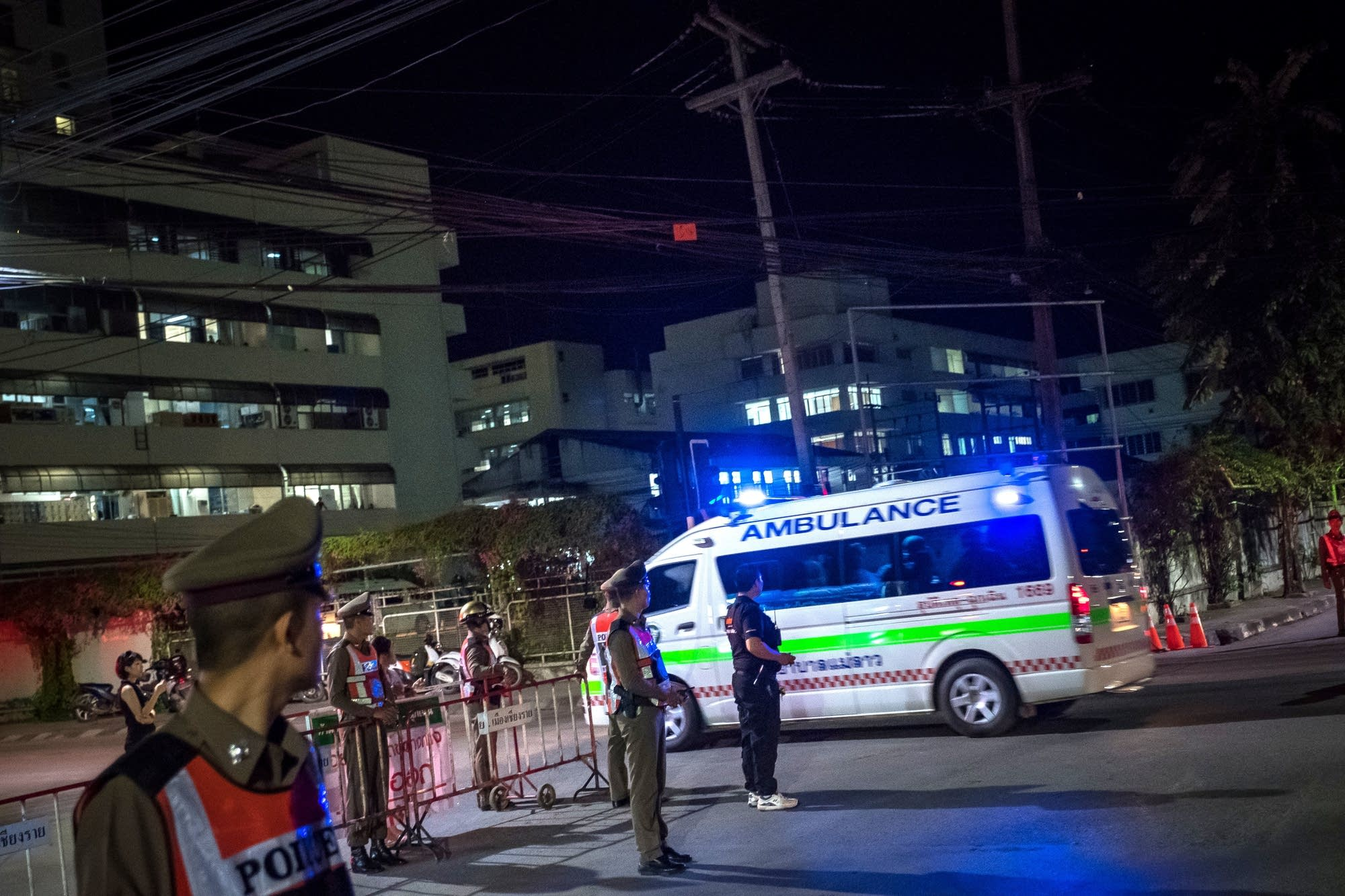 Rescued boys and their coach arrive at Chiangrai Prachanukroh Hospital.