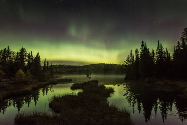 The northern lights in the sky.