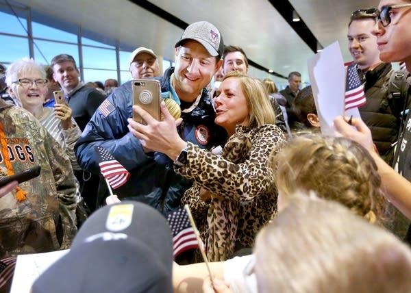 Nancy Litman of Duluth, a friend of John Shuster, takes a selfie.