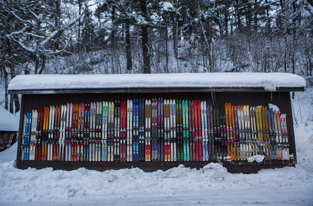 Skis mounted on the side of a shed