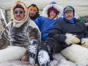 Cristina Mittermeier relaxing with Inuit hunters