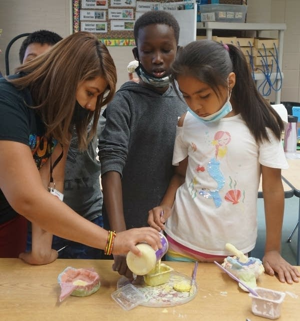 children work on an art project