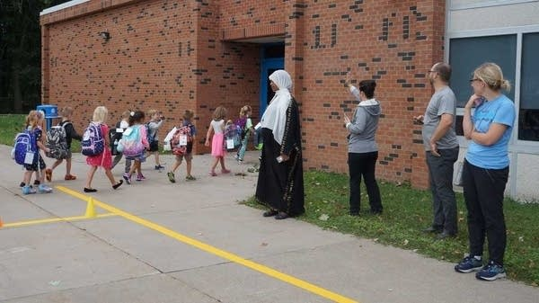 Students go to school on the first day of the new school year.