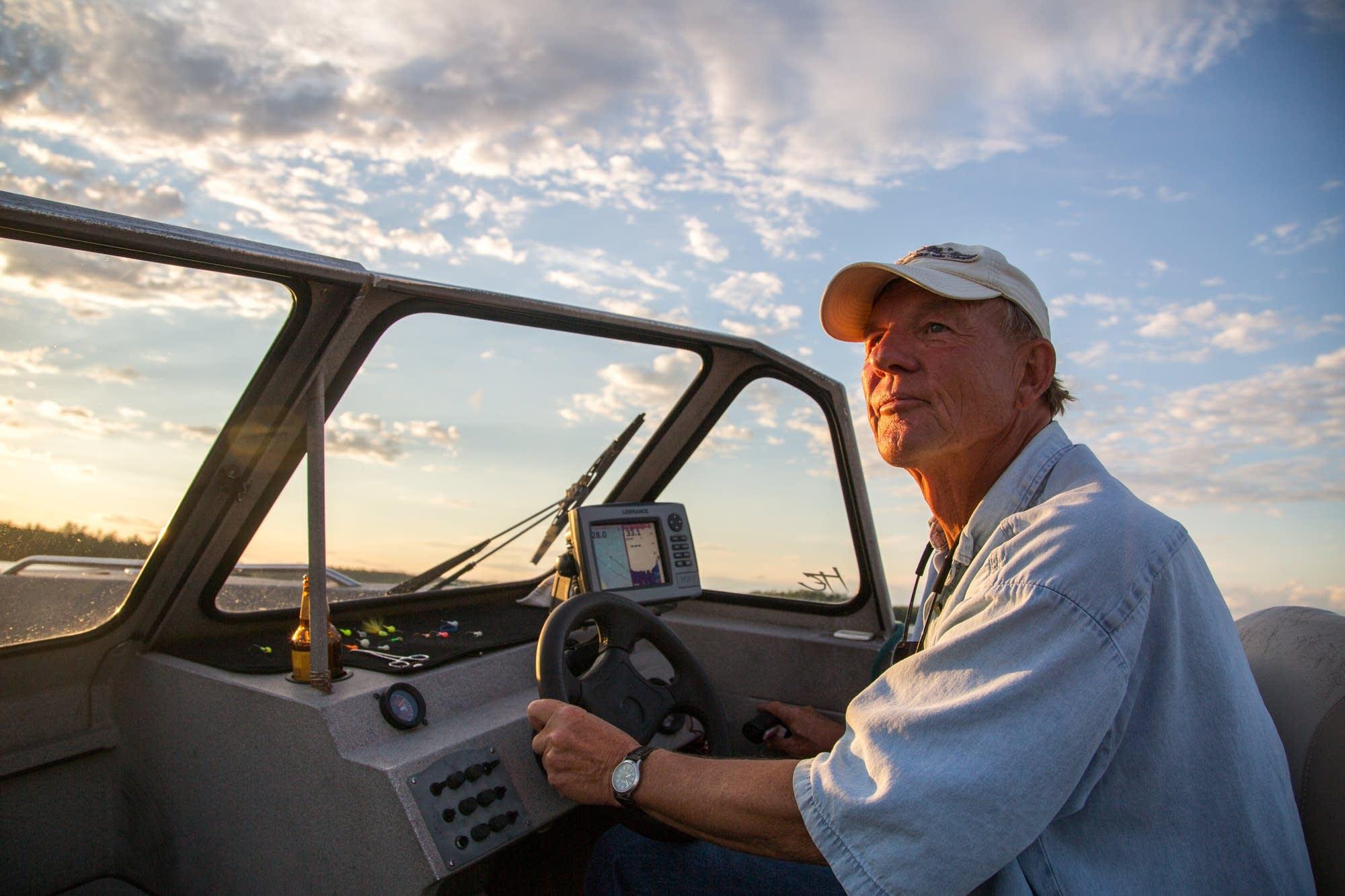 Butch Eggen drives his boat.