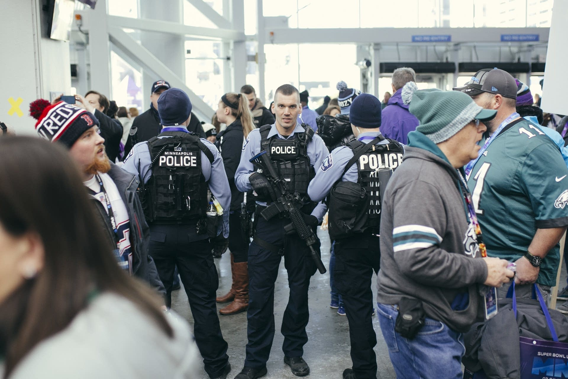 Minneapolis police stand on guard with assault rifles inside the stadium.