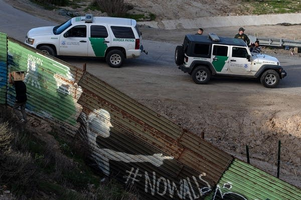 A woman and a child are processed by border patrol agents.