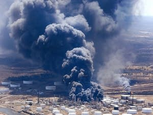 The Husky Energy refinery burns as seen from the air Thursday.