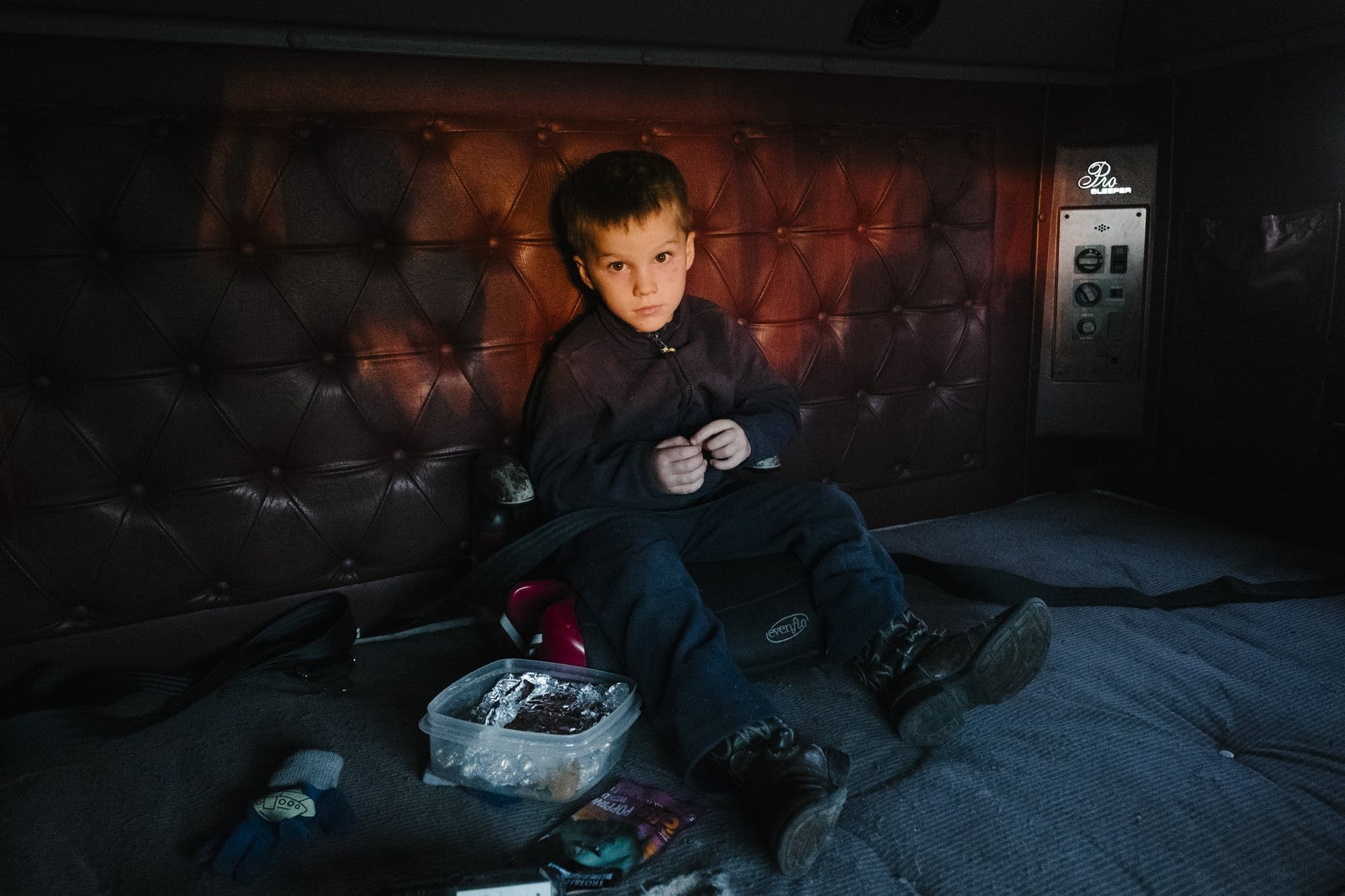 Jonathan Collins rides in the backseat of his dad's truck.