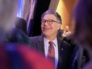 US Senator Al Franken turns to greet people.