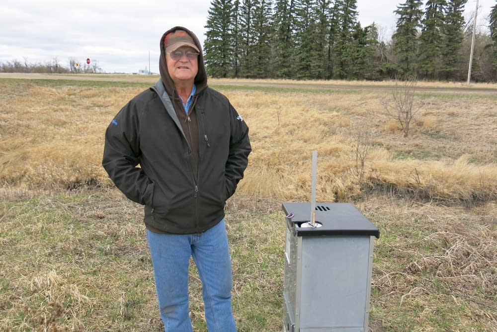 Gerry Zimmerman stands near drainage control.