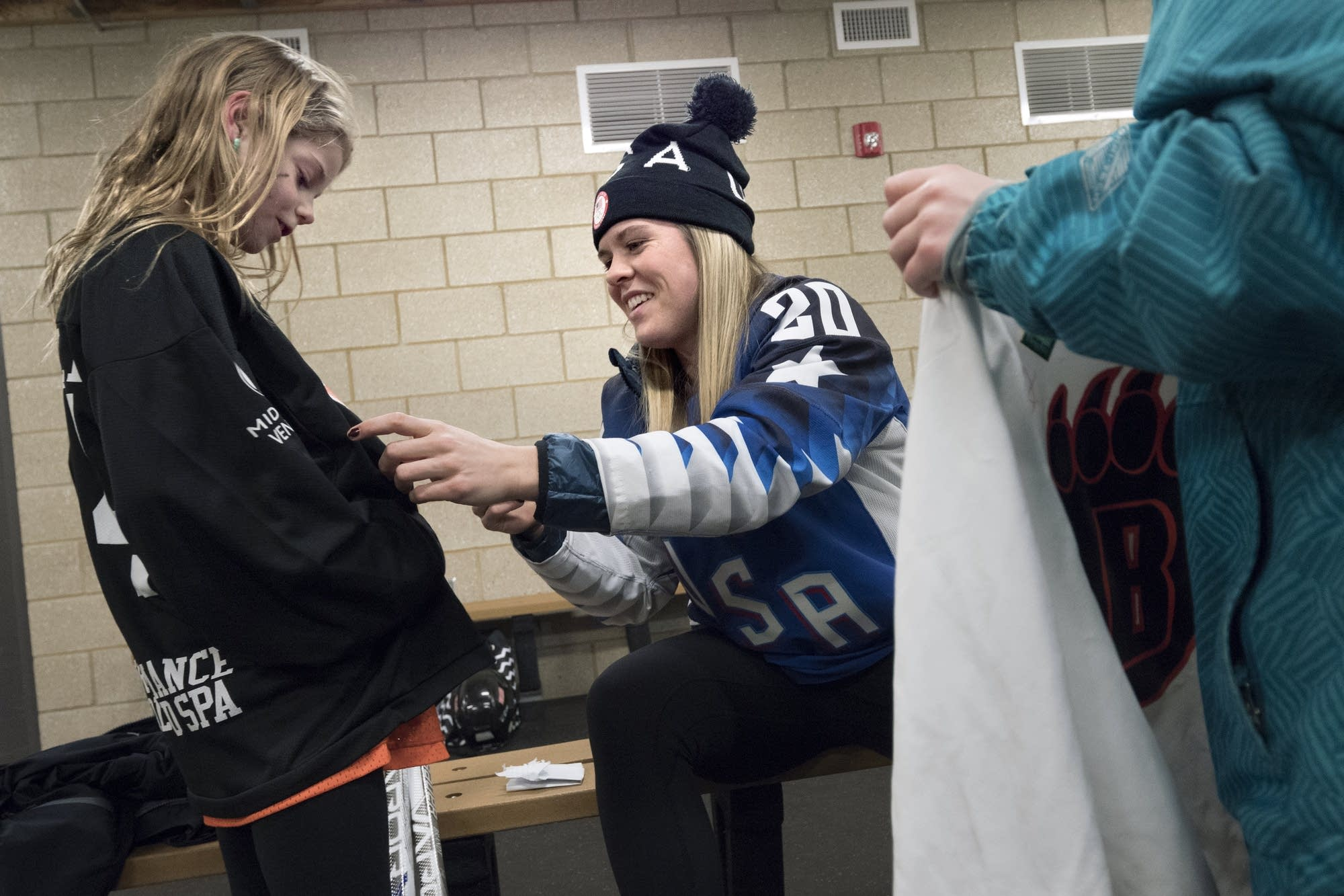 Hannah Brandt signs a shirt in the warming hut.