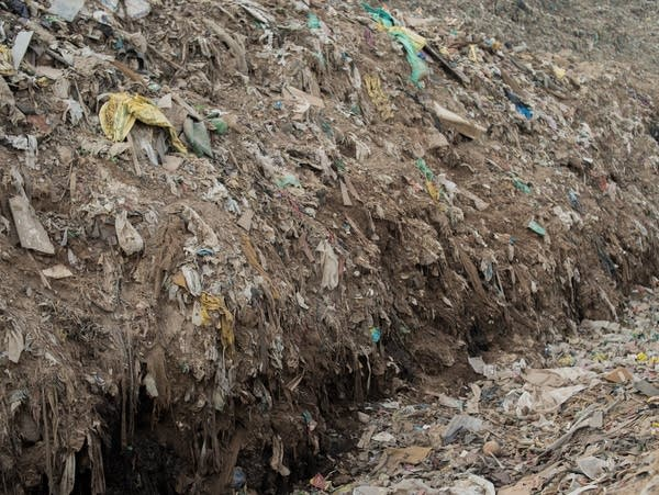 Trucks have bulldozed a switchback road up the Ghazipur landfill