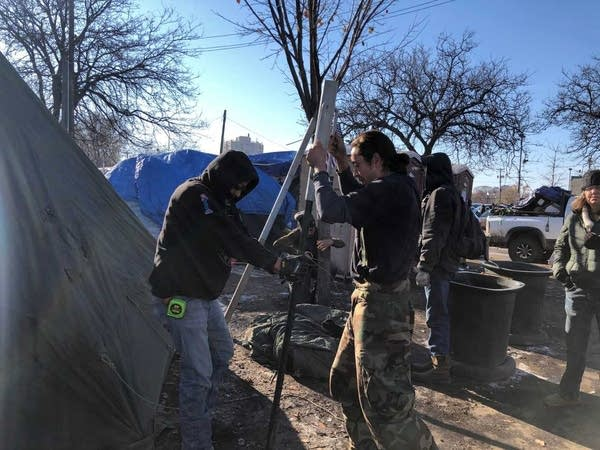 Warming tents go up at site of long-standing encampment in