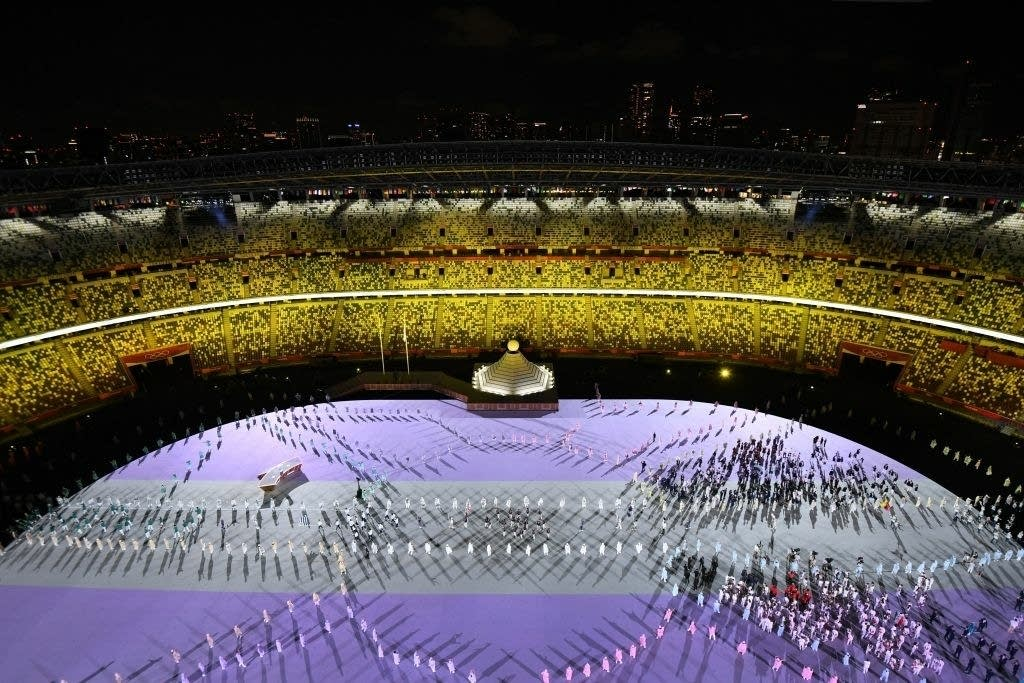 Performers and participants in the Tokyo Olympics opening ceremony.
